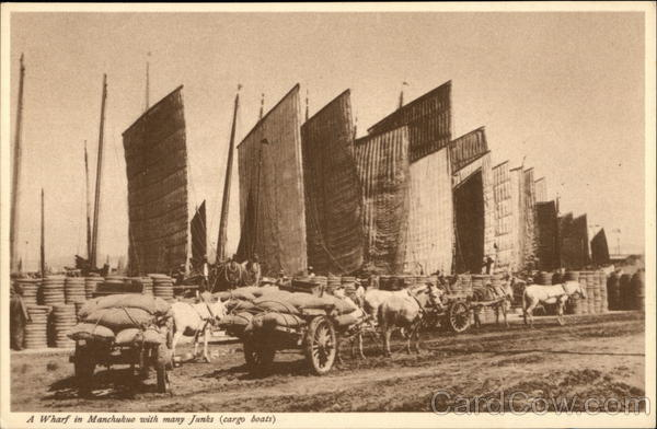 A Wharf in Manchukuo with many Junks (cargo boats) China