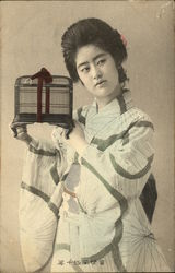 A Japanese woman holding a birdcage.