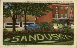Floral Emblem in Washington Park and FOOE Building Postcard