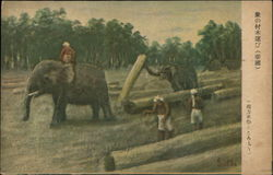 Elephants and Workers Moving Logs