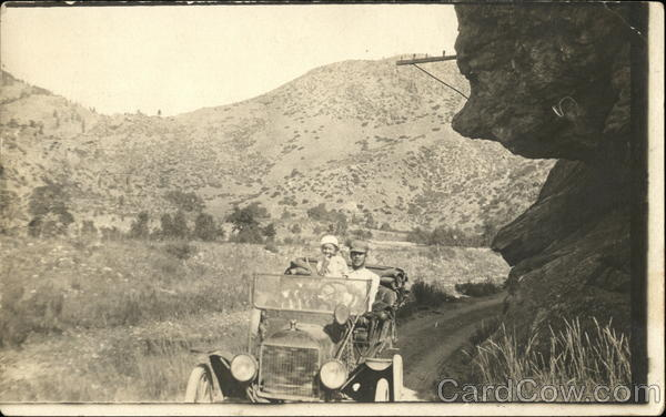 Man and Small Child Riding in Car Colorado Cars