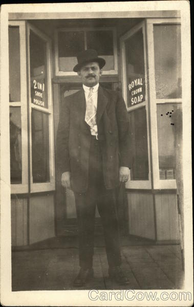 Man Wearing Suit, Standing in Front of a Shop Men
