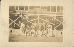 Men Posing In Front of Home Under Construction