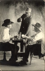 Portrait of Cowboys Playing Cards