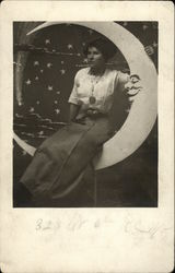Woman Sitting on a Paper Moon