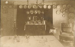 Dining Room with Plates Hanging on Wall