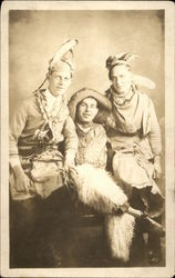 Three Men Dressed as Cowboy and Indians