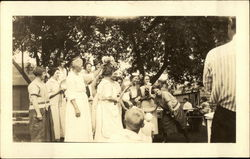 A Group of Women Playing Instruments Postcard