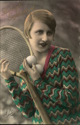 Young Woman with Tennis Racquet and Balls