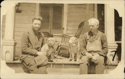 Two Men on Porch with Pair of Dogs