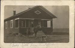 Woman on a Horse in Front of a House