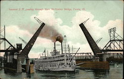 Steamer JS passing through New McKinley Bridge