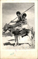 Two Children Riding a Donkey