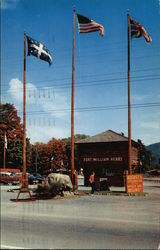 French, American and British Flags fly above the Blockhouse and Entrance to Fort William Henry