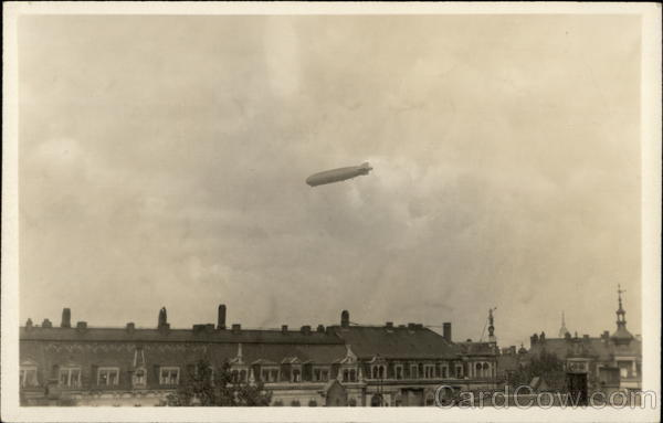 Blimp Flying High Above Buildings Airships