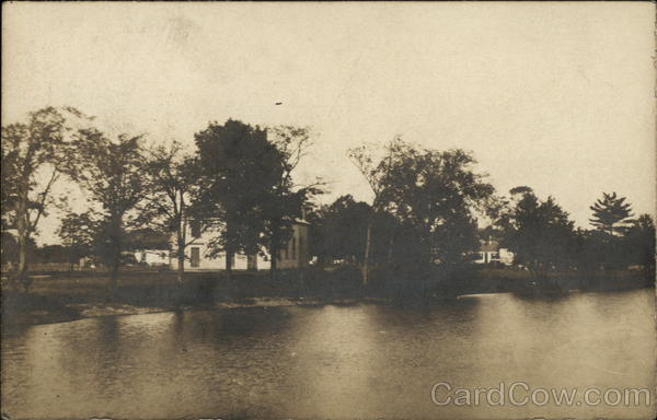 View of a Home on the Shore of a Lake Plainville Massachusetts