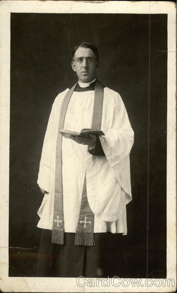 Priest Holding Bible Religious