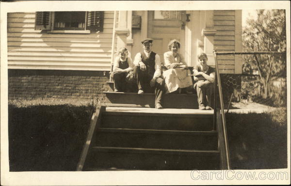 A Family Posing on the Front Steps of their Home New Britain Connecticut