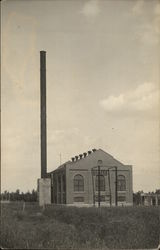Factory Building with Large Chimney