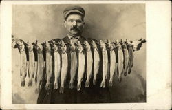 Man Holding a lot of Fish