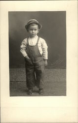 Boy in Overalls and Cap