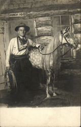 Man in Cowboy Attire Posing with a Horse