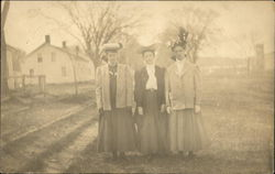 Photo of Three Women Stanfing Outdoors