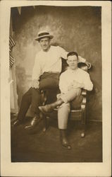 Photo of Two Men Sitting
