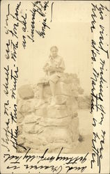 Woman Posing on Stone Pillar with Dog