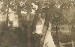 Photo of Woman with Child near Tree