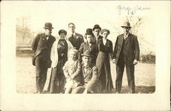 Large Family in Formal Attire Posing in an Open Yard