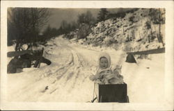 Toddler in Wagon on Snow