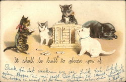 Kittens with minitaure building