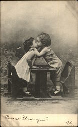 Two Children Kissing at Table