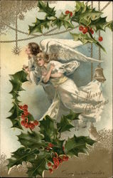 A Merry Christmas - Two white angles surrounded by holly