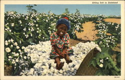 Black Child Sitting on Cotton Bale