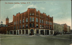 The Stricklan Building Carthage, NY Postcard