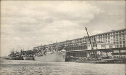 Ships and Barges of the Tanks Tied Up Along the Wall