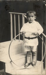Boy Standing on Steps With Hoop