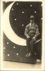 Portrait of Man Sitting on Paper Moon