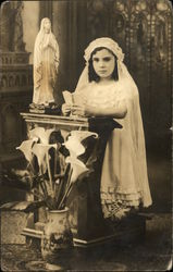 Young Girl Kneeling in Church