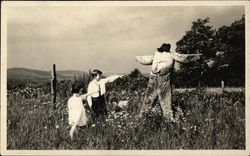 Children in Field Pointing at Scarecrow
