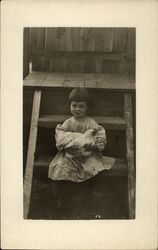 Edith B. Holding Chicken on Stairs