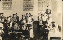School Children and Teacher in School
