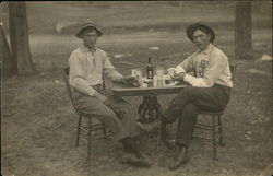 Two Men Playing Cards at Table