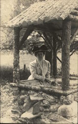 Woman at Rustic Wishing Well