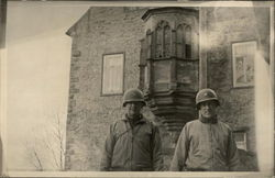 Two Soldiers In Front of Brick Building