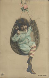 Girl in Swing Holding Glass
