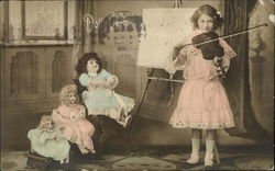 Little Girl Playing Violin for her Dolls