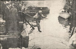 First Survivors Leaving Upturned Side of Boat Postcard